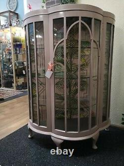 Restored soft pink art deco cocktail cabinet. Tall standing glass front display