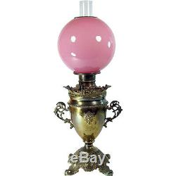 Victorian Banquet Lamp with Lion Heads and Cased Pink Art Glass Globe 1880's